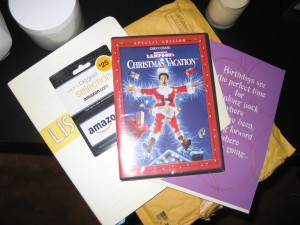Amazon gift certificate, National Lampoon's Christmas Vacation, card and List Book from Liz